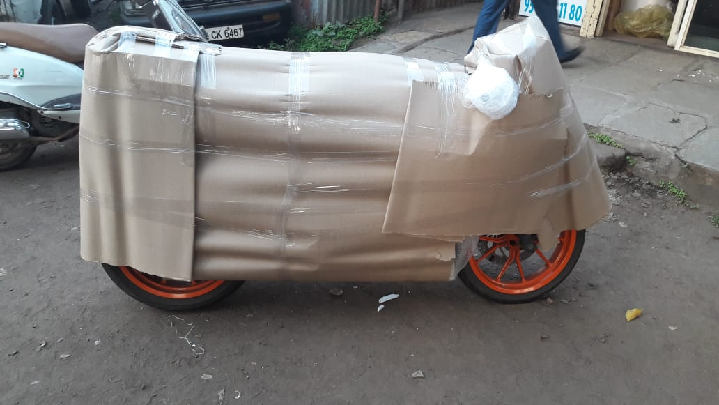 KTM Rc Bike Packing And Moving From Pune To Bagaluru, Using Material Like, Tharmacol, Airbubble, Foam Sheet, Brown Sheet, Lamination & Tape.